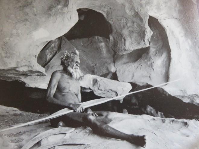 An Aboriginal Arunta man sits near Uluru (Ayers Rock) in Australia.